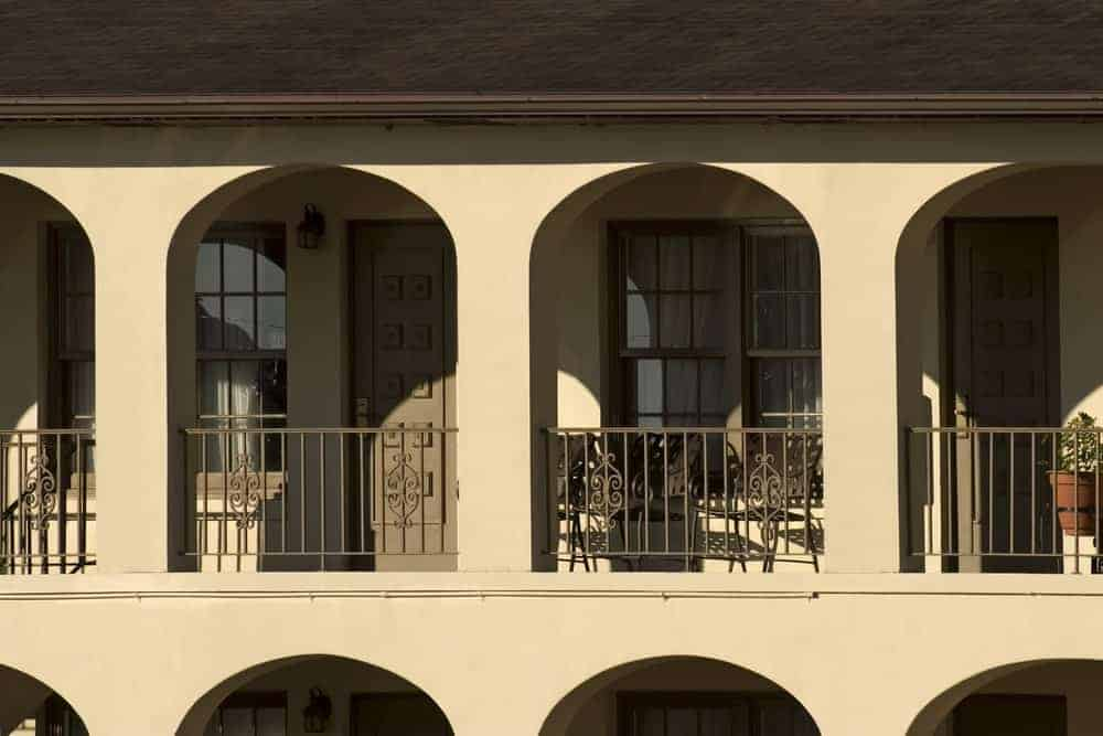 A hotel with arched windows on the balcony in St. Augustine, Florida.