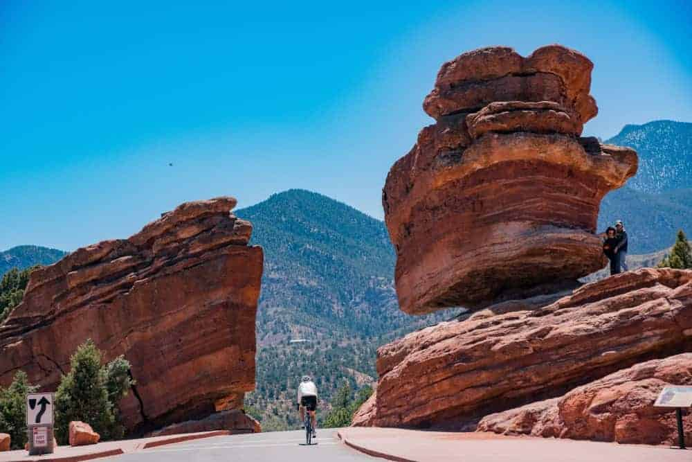 A lone cyclist heading toward the Garden of the Gods.