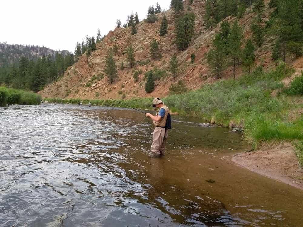 A man fishing by the Chessman Canyon.