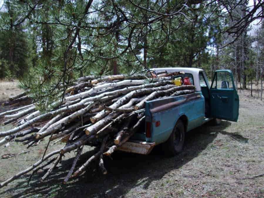 A truck carrying firewood.