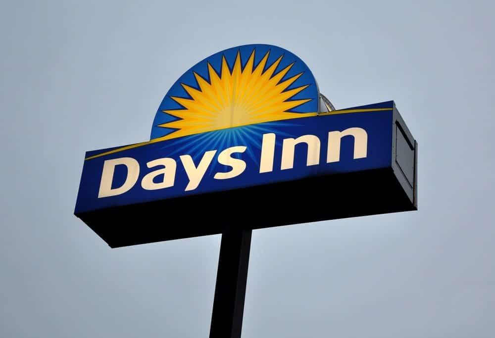 Days Inn by Wyndham signage against a clear sky.