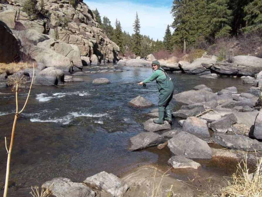 A person fishing at Eleven Mile Canyon.