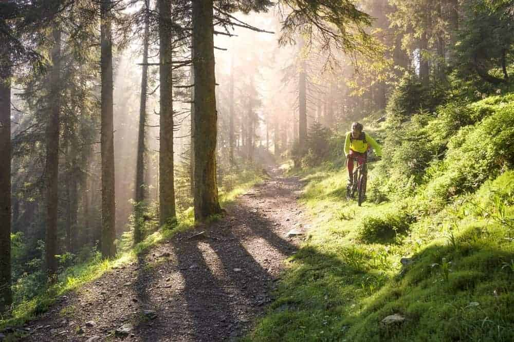 A lone cyclist at a mountain hiking trail.