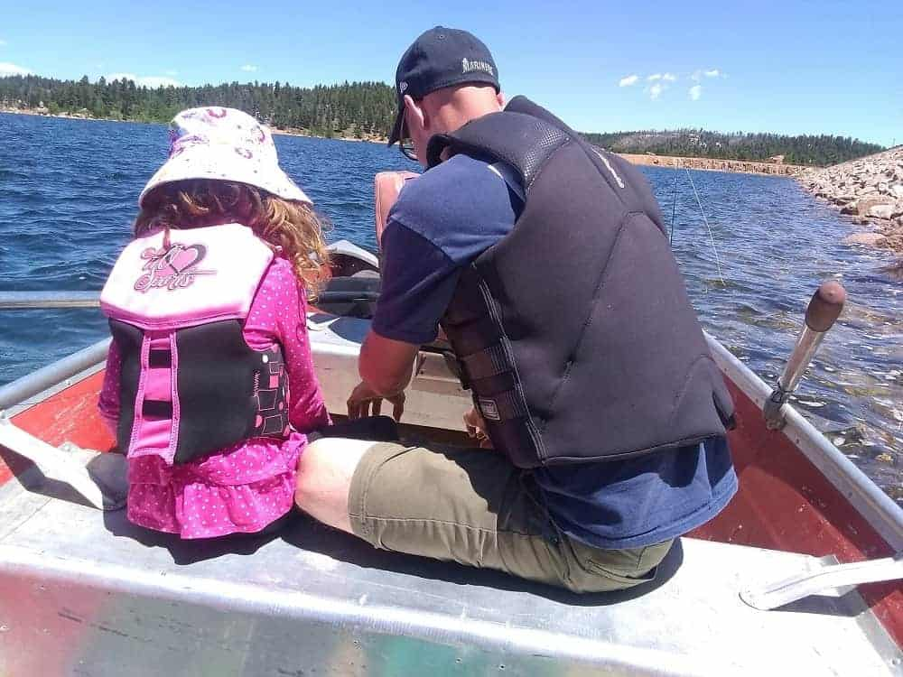 A father and daughter fishing at the Rampart Reservoir.