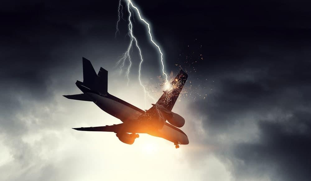 Lightning strikes a plane mid-air.