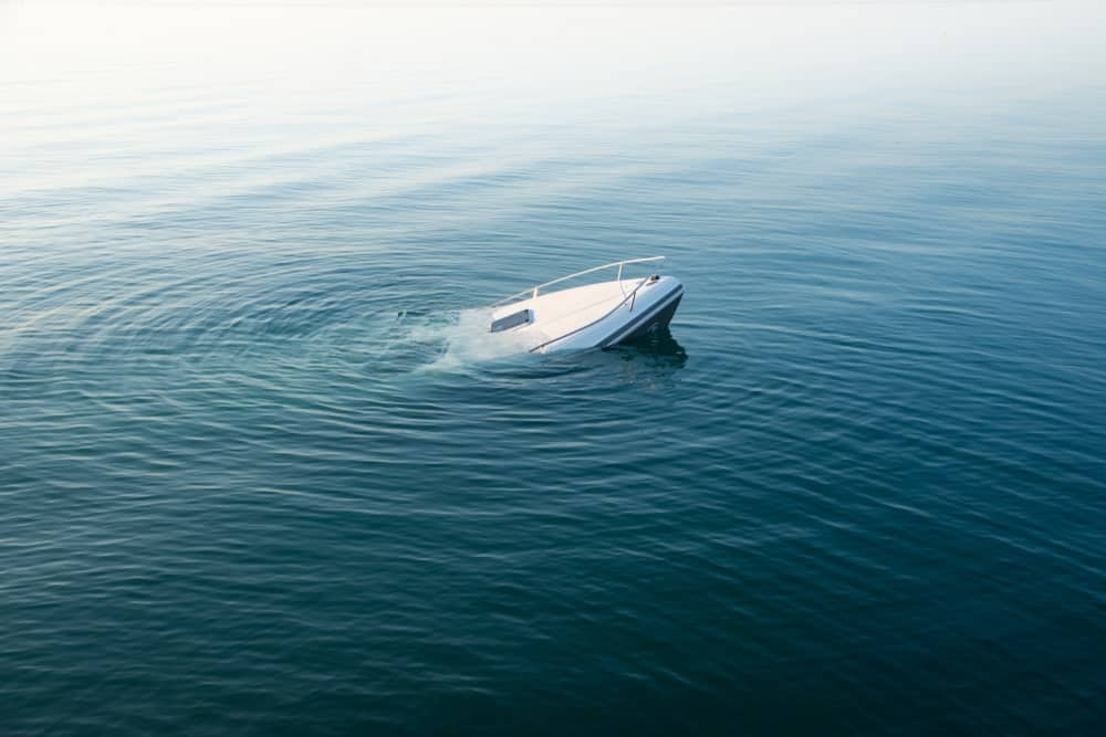 An aerial view of a boat sinking.