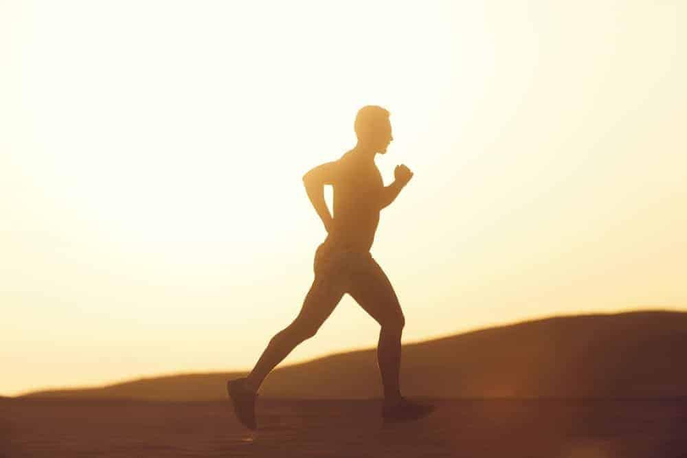 Man running on a dune.