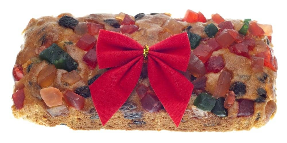 Fruitcake with a red ribbon at the center.