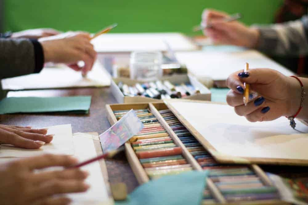 Busy hands doing artwork.