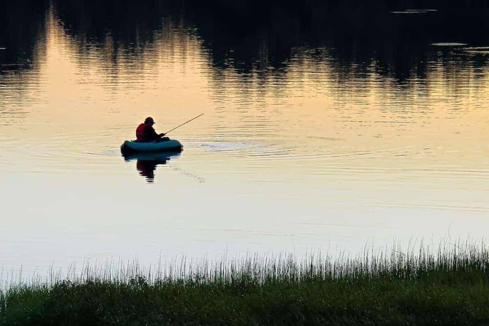 A lone man fishing on Lone Lake.