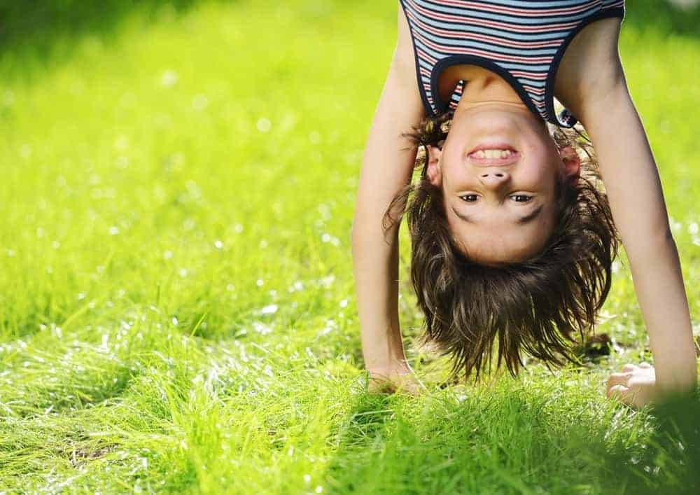 A kid playing on the grass of the South Whidbey Community Park.