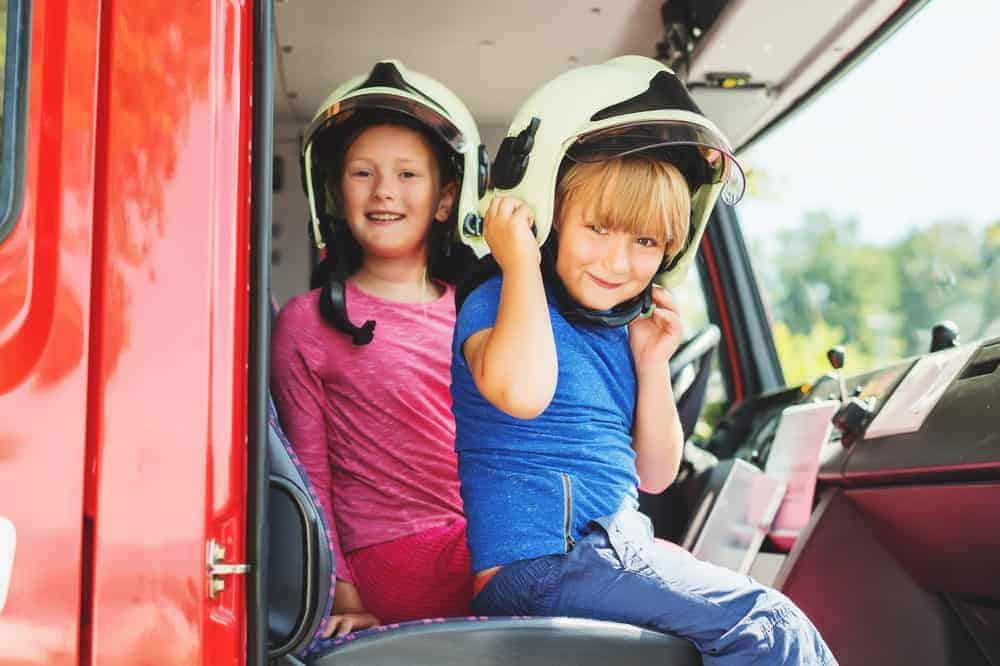 Two kids enjoying the Touch-a-Truck Day.