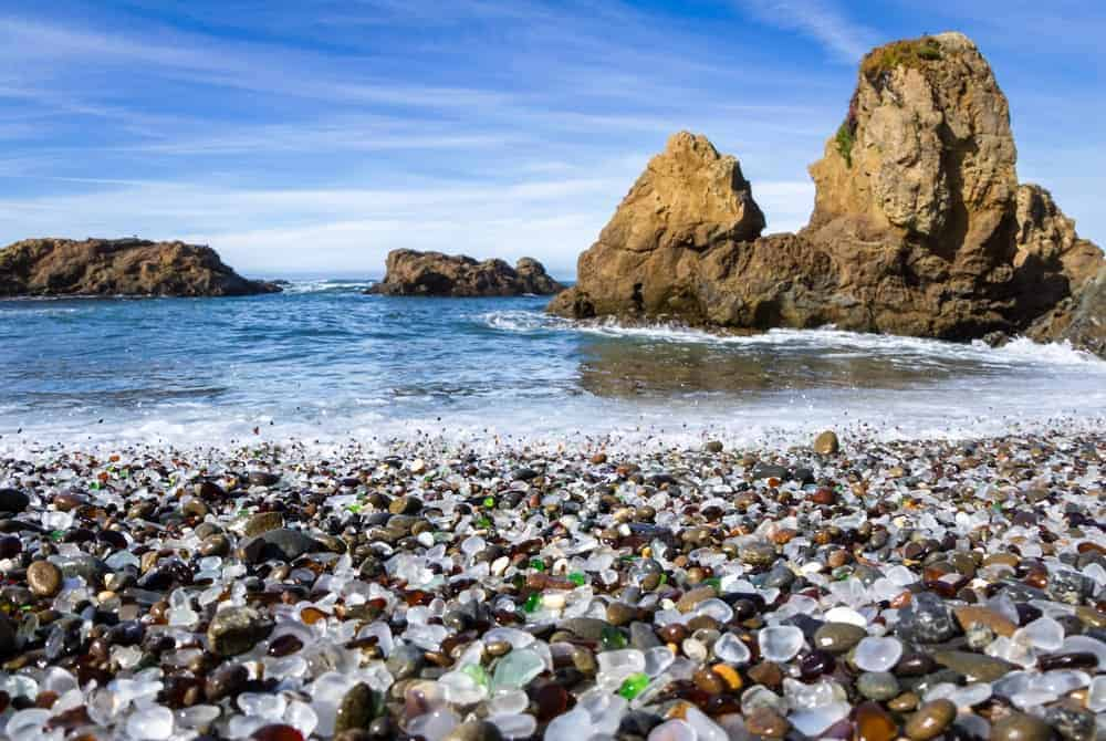 Blankets of glass pebbles on a beach.