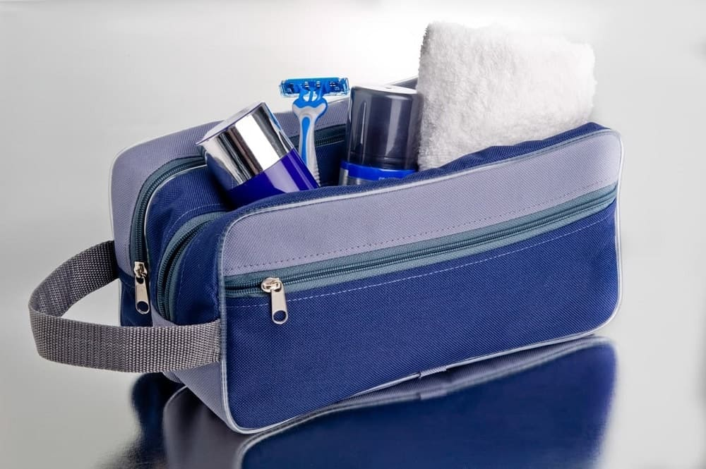 A look at a blue travel toiletry bag.