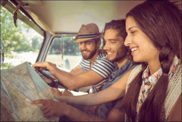 Friends on a Road Trip Looking at a Map.