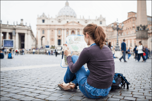Young Woman Tourist Studying a Map.
