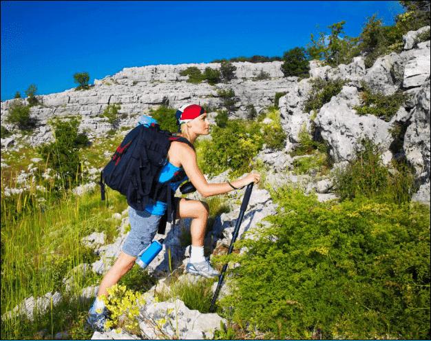 Female Backpacker on a Mountain.