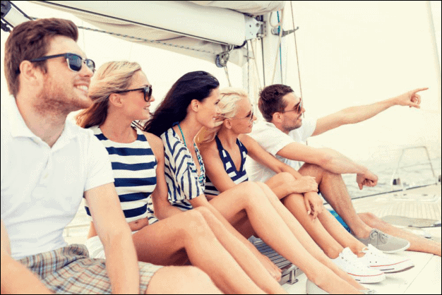 Group of Friends Enjoying on a Sailboat.