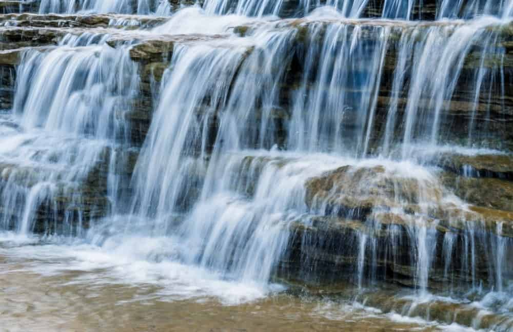 A close look at a multiple tiered waterfall.