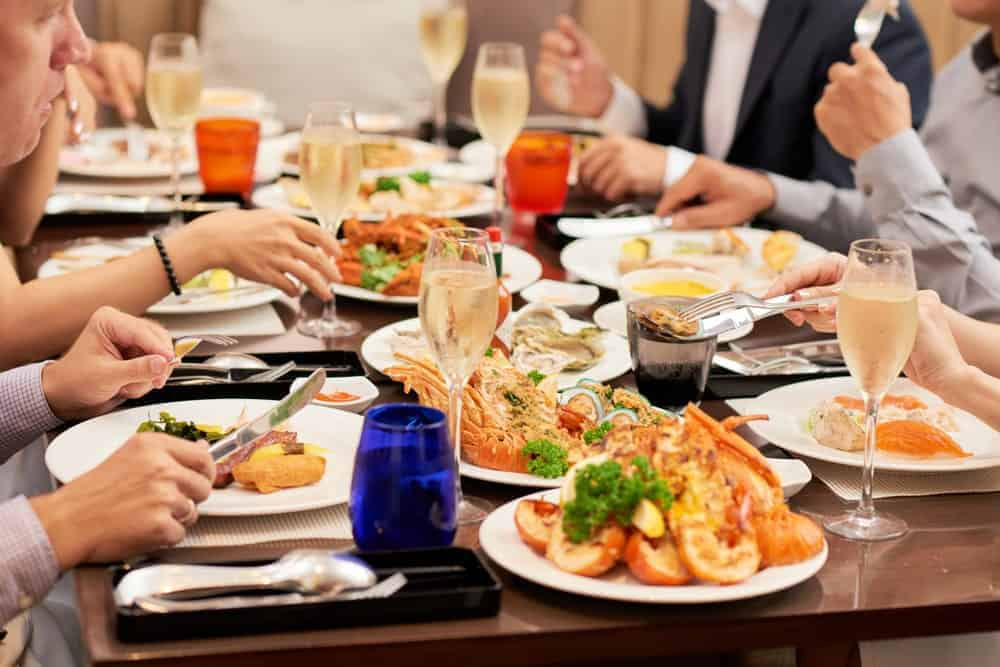 A close look at the seafood dinner served to a group of people.
