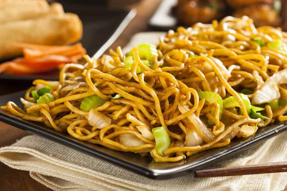 A plate of freshly-cooked Asian chow mein noodles.