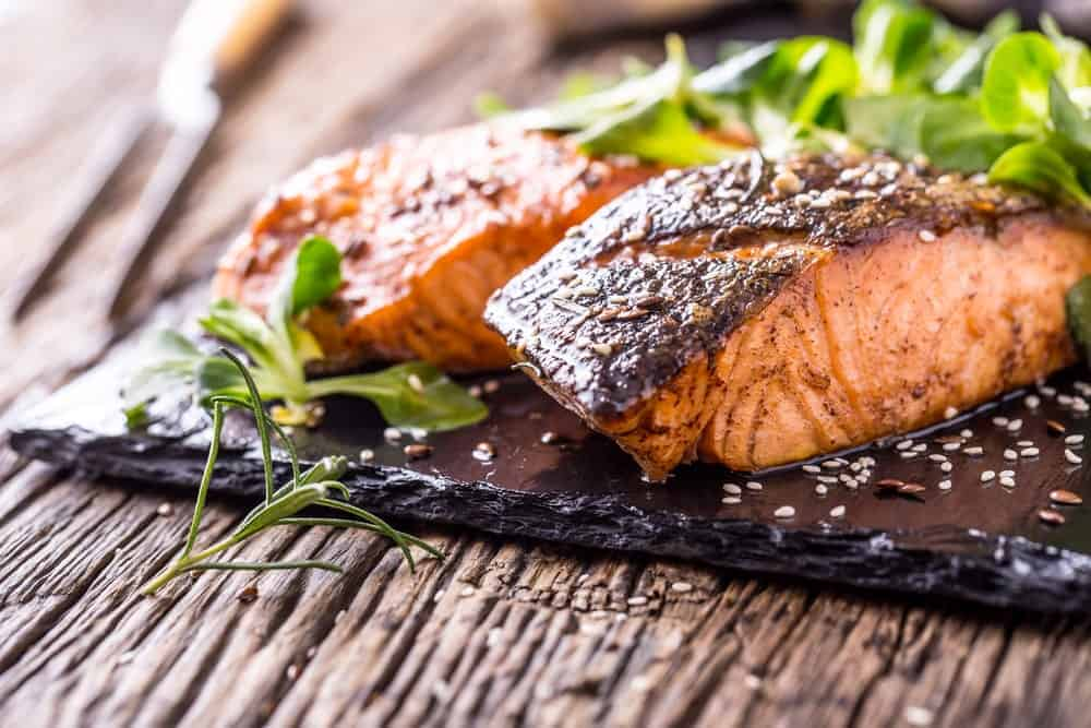 Grilled salmon fillet slices with spices.