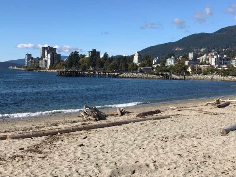 View of the pier at Ambleside Beach in West Vancouver, BC.