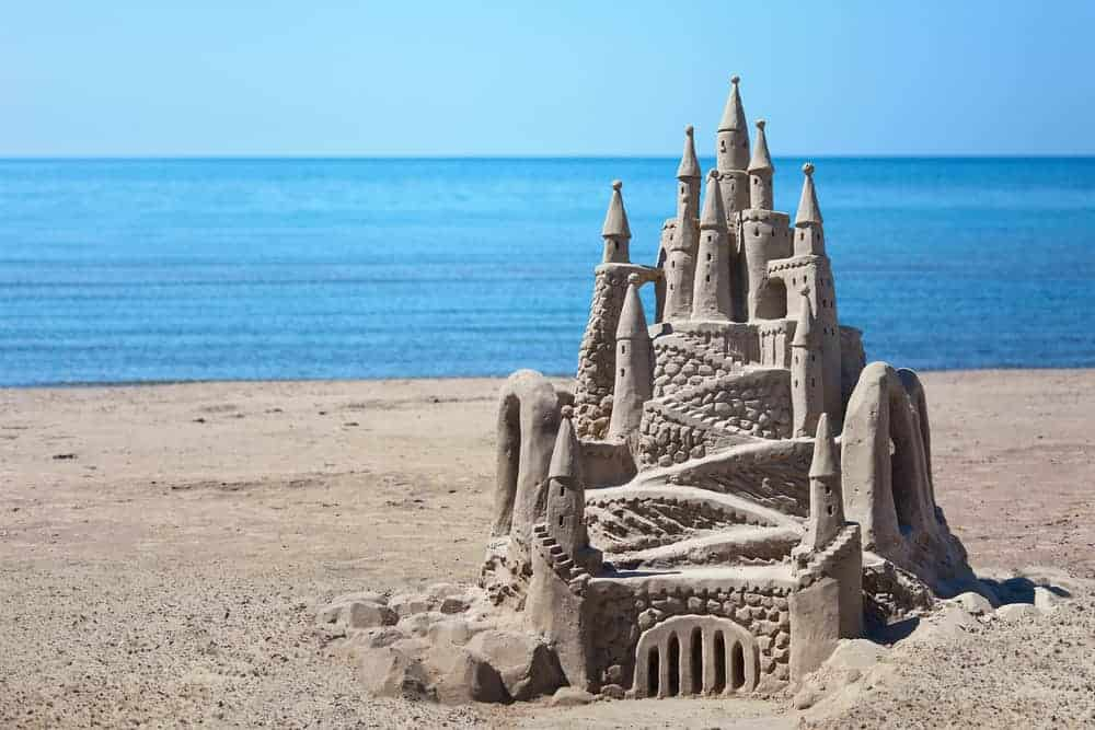 A close look at a sand castle on the beach.