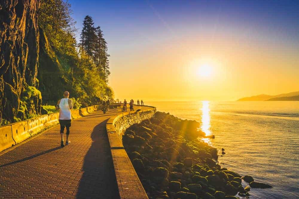A view of the sunset along the Stanley Park Seawall in Vancouver, BC.