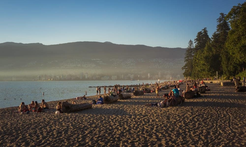 A photo of a crowded Third Beach on a hot Summer day in Vancouver, BC.