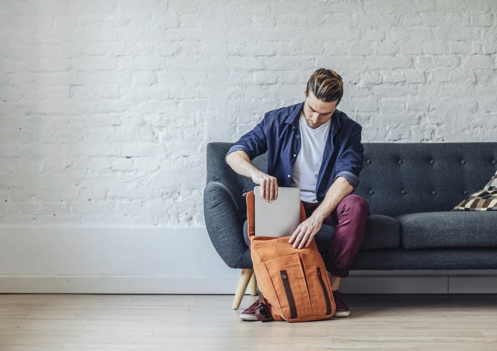 A man organizing his work daypack.