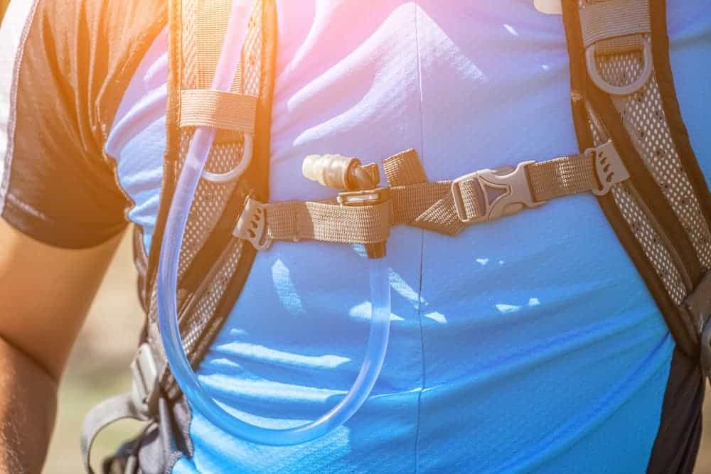 A close look at a man's cycling/running hydration pack.