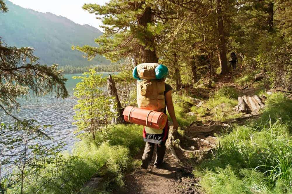 A man carrying a large trekking backpack.