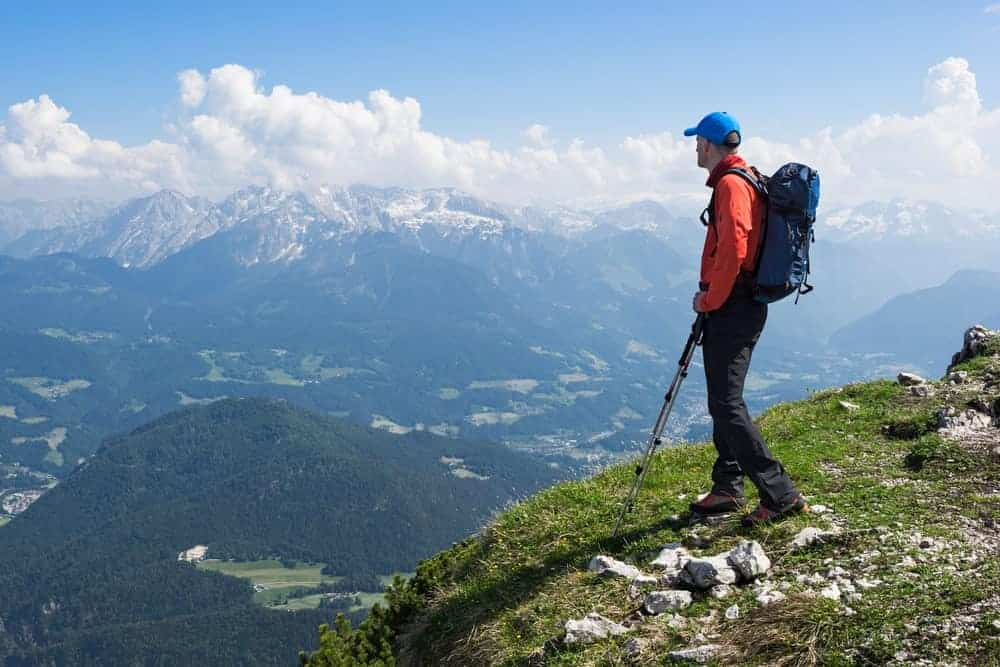 A man carrying a hiking daypack.