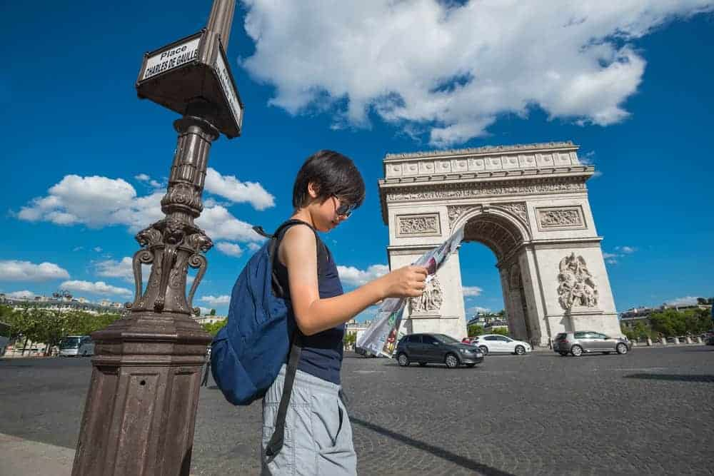 A kid wearing a sightseeing daypack.