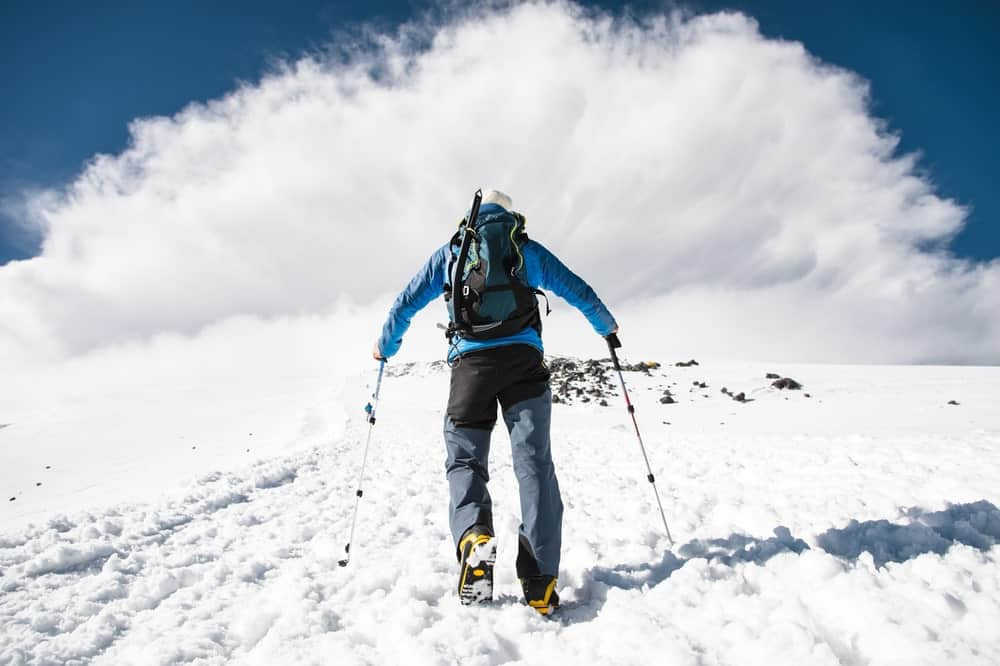 A man carrying a snowsports daypack.