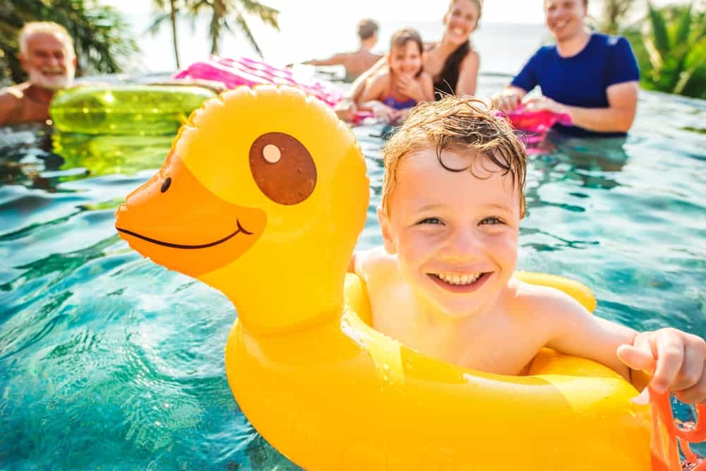 A close look at a family enjoying their time at the pool of the resort.