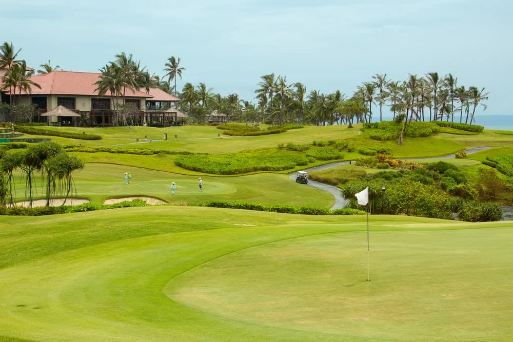 A view of a tropical luxury golf resort.