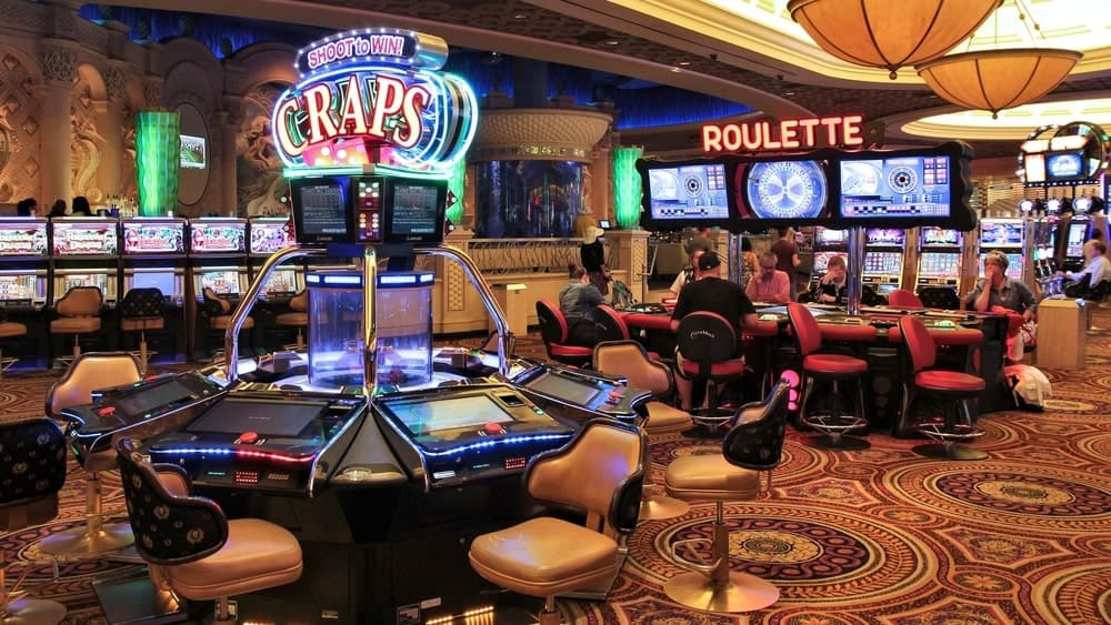 A close look at a casino with colorful and bright machines for various games.