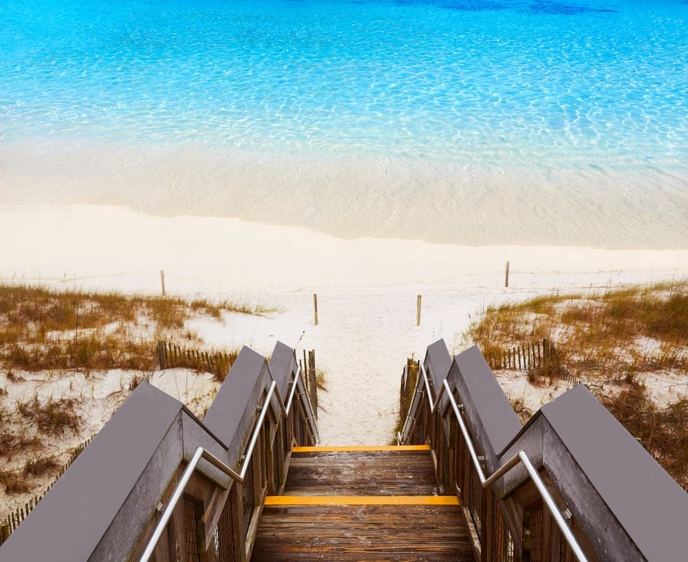 A wooden stairway leading to the pristine waters of Destin beach.