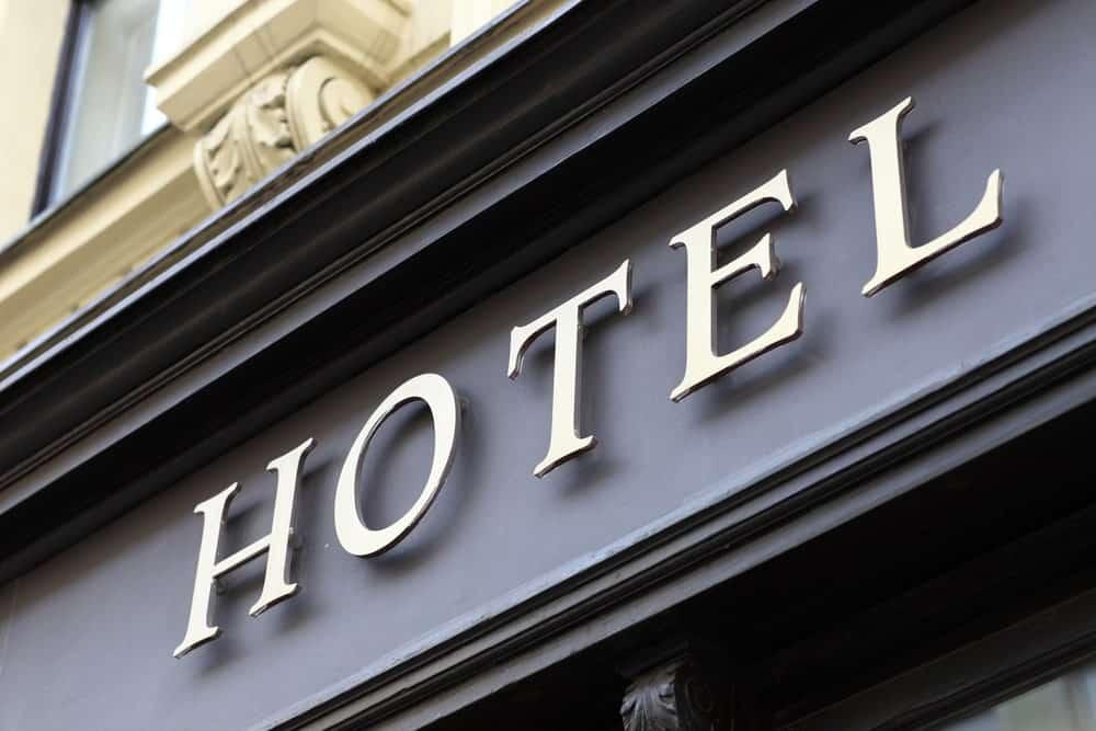 A close look at a metallic hotel signage at a building facade.