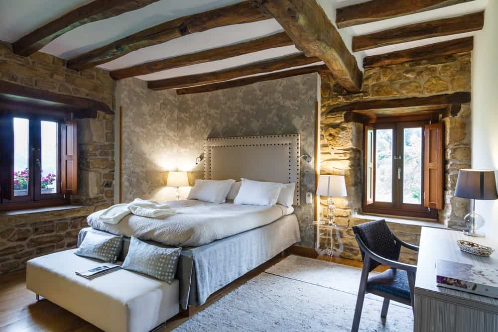 A look at the rustic bedroom of a farmhouse hotel.