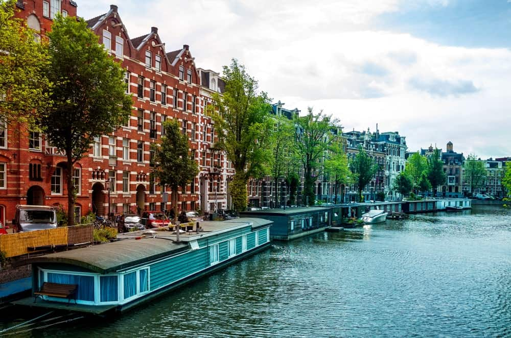 A row of hotel barges in Amsterdam.
