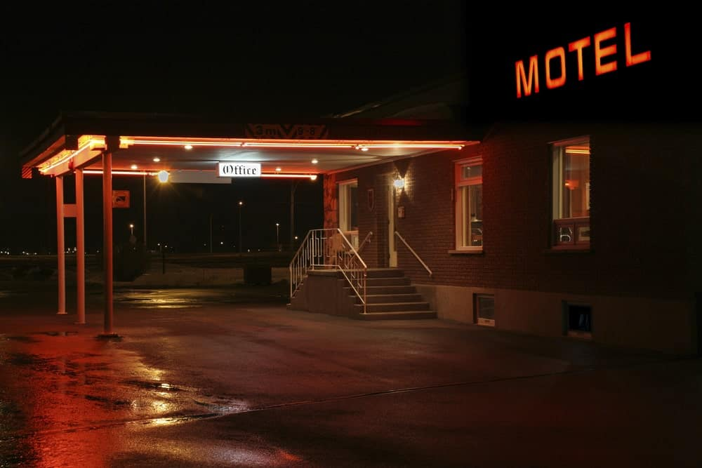 A nighttime look at the main entrance of a motel.