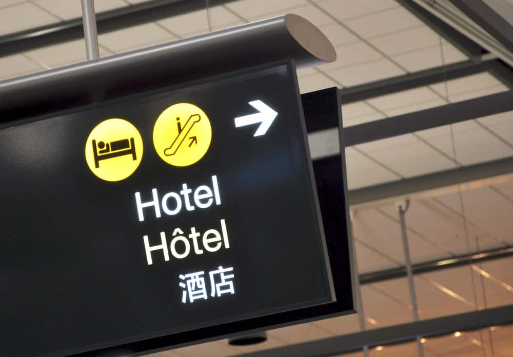 A close look at the hotel signage and directions at the airport.