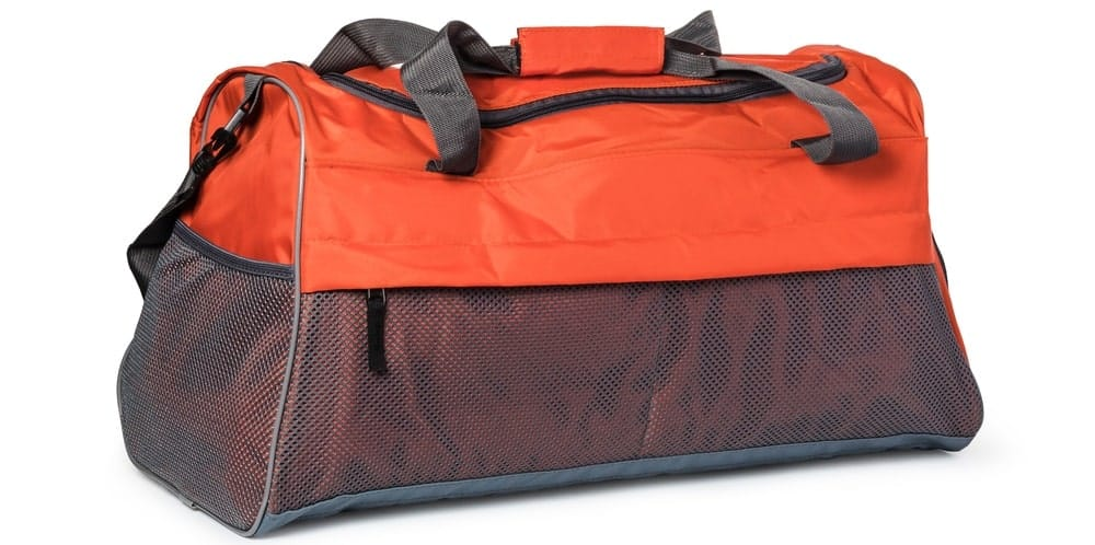 A close look at an orange duffel bag.