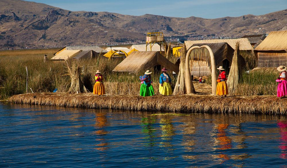 A look at Lake Titicaca and its locals wearing colorful garments.