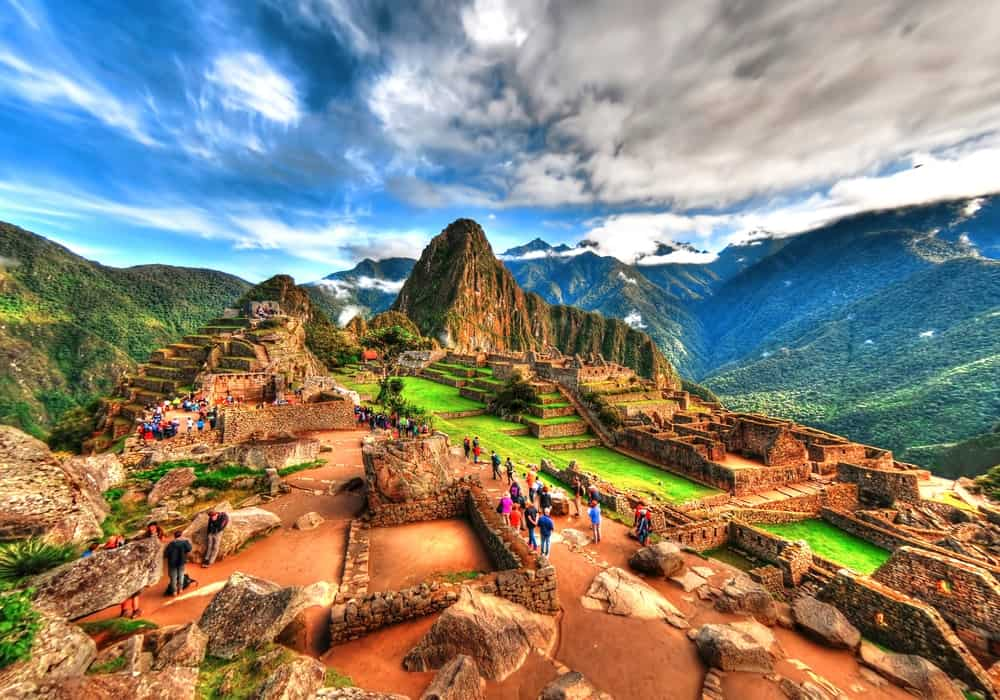 An aerial view of Machu Picchu with tourists.