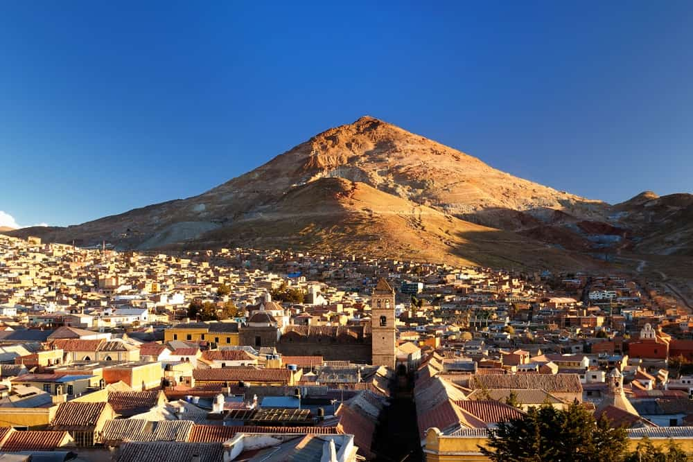 This is a look at the rooftops of Potosi in Bolivia that is set against the backdrop of a rainbow-colored mountain, the Cerro Rico.