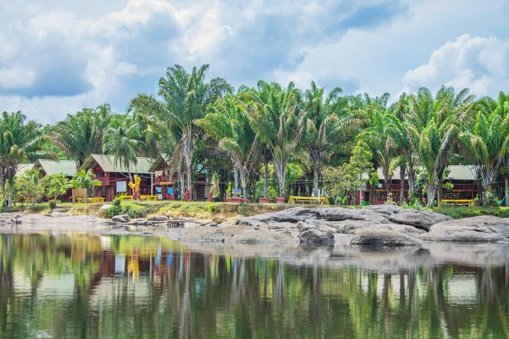 A look at the colorful cabins along the Suriname river near Menimi, Djemongo, Upper Suriname.